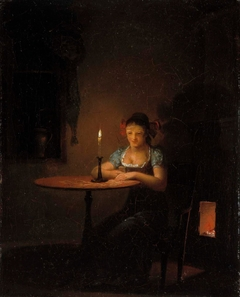 Young Woman Playing Patience