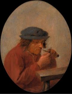 A peasant cutting his thumbnail