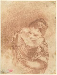 Borstbeeld van een zich vooroverbuigende jonge vrouw
