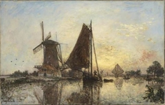 En Hollande, les barques près du moulin