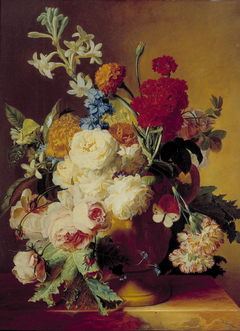 Flowers in a vase on a marble slab