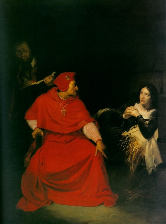 Joan of Arc is interrogated by The Cardinal of Winchester in her prison