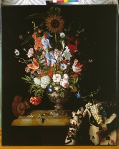 Still life with flowers in a vase, oriental carpet and a squirrel