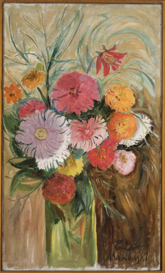 Zinnias and asters in a glass jar